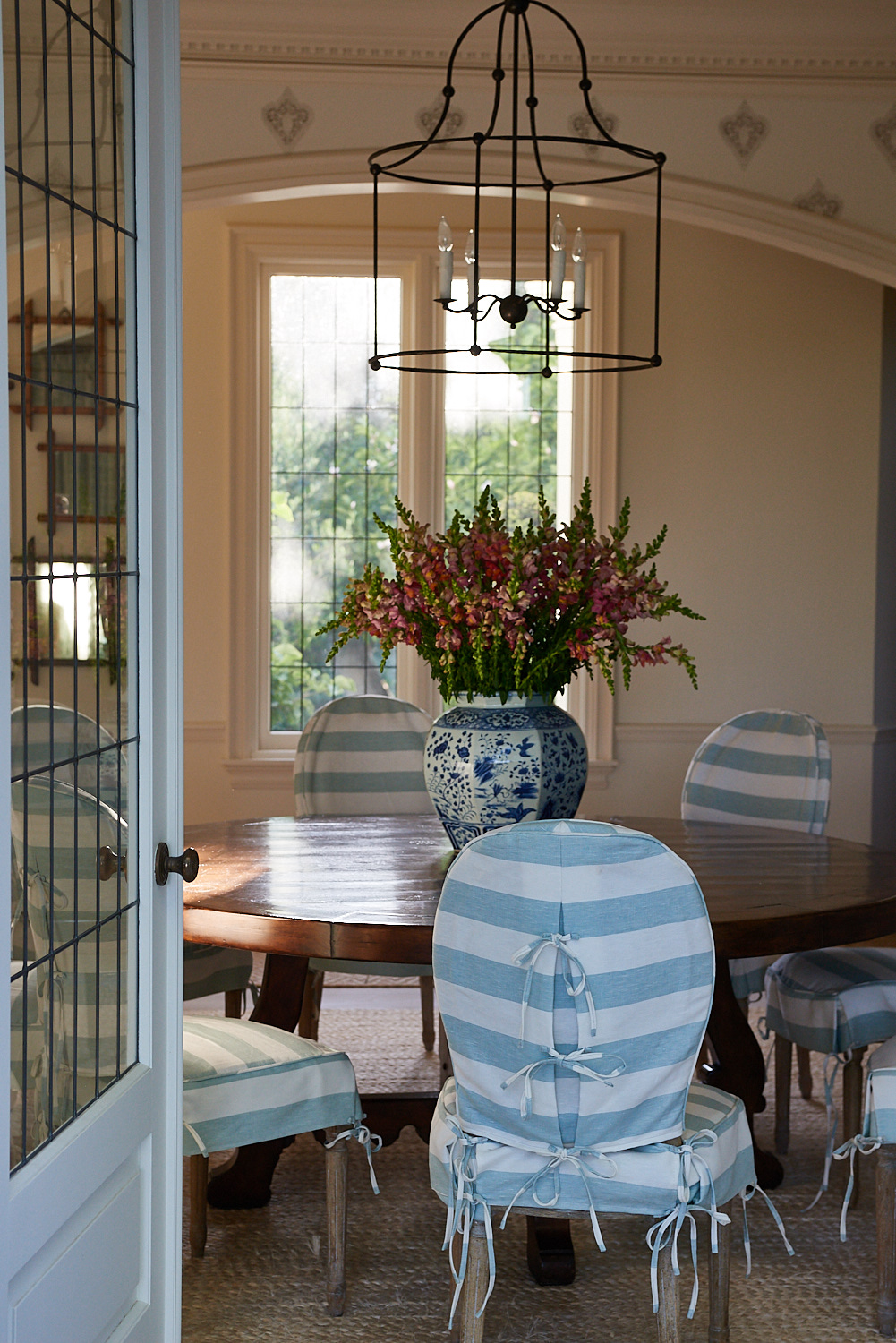 Dining room chairs with striped fabric coverings