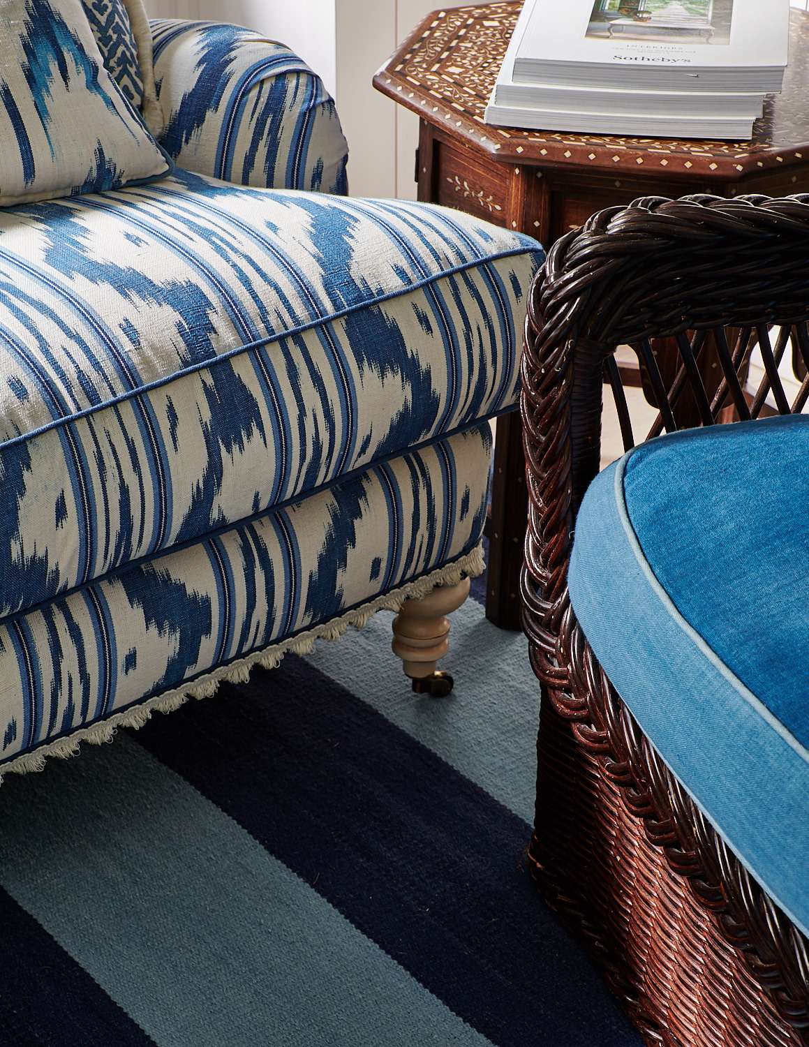 Detail of patterned sofa with petite tassels