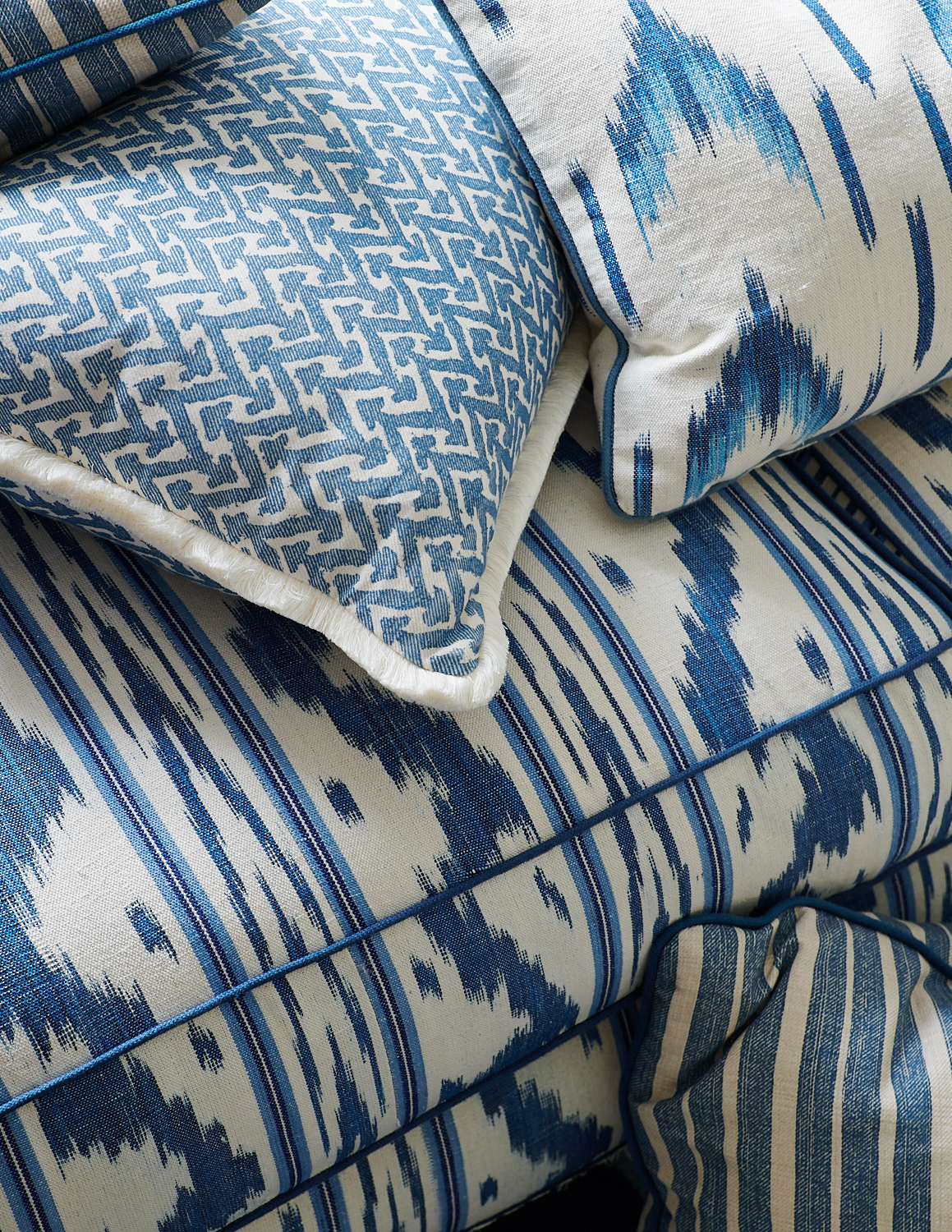 Detail of patterned sofa with custom throw pillows