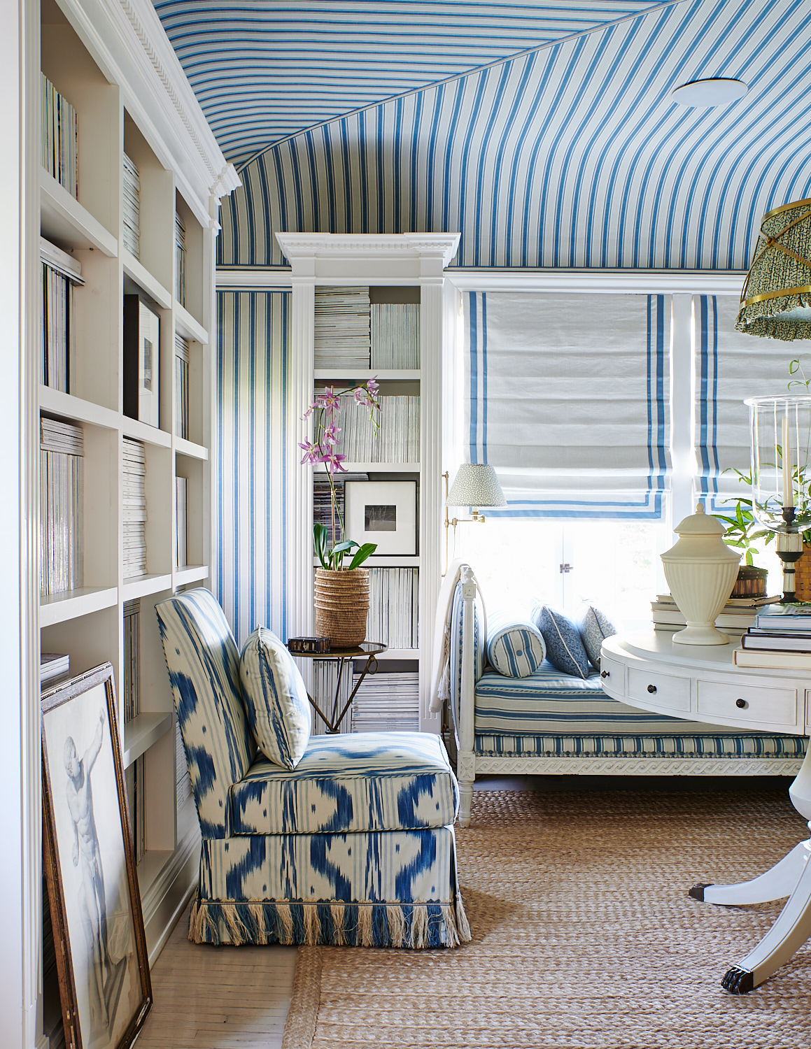 Upholstered chair with tasseled skirt, divan and matching bolster, with upholstered ceiling